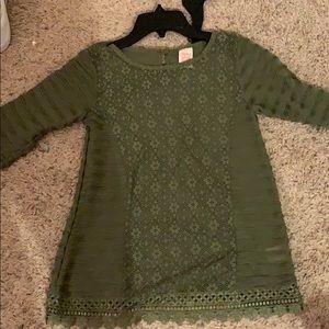 A olive green girls shirt